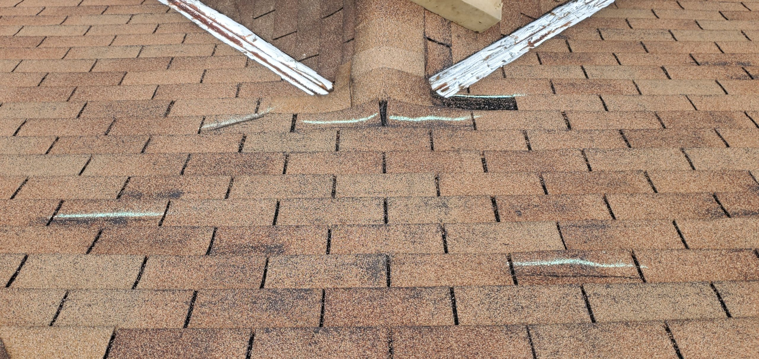 this picture shows 5 wind creased roof shingles that can blow off of this roof at any time in knoxville tn
