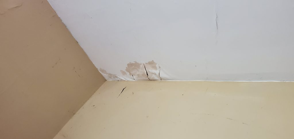 this is a picture of ceiling stains from a roof leak on the inside of a home in knoxville tn