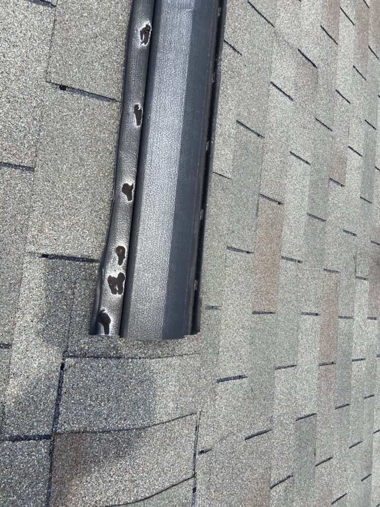 this is a picture of an old metal ridge vent on a roof, these ridge vents have bad problem with causing roof leaks