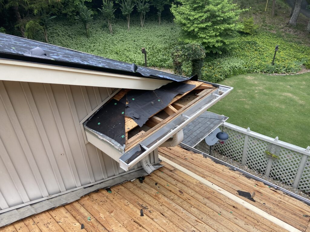 This is a picture of the deck boards  and deck boards at the eave of the roof that needs to be replaced.