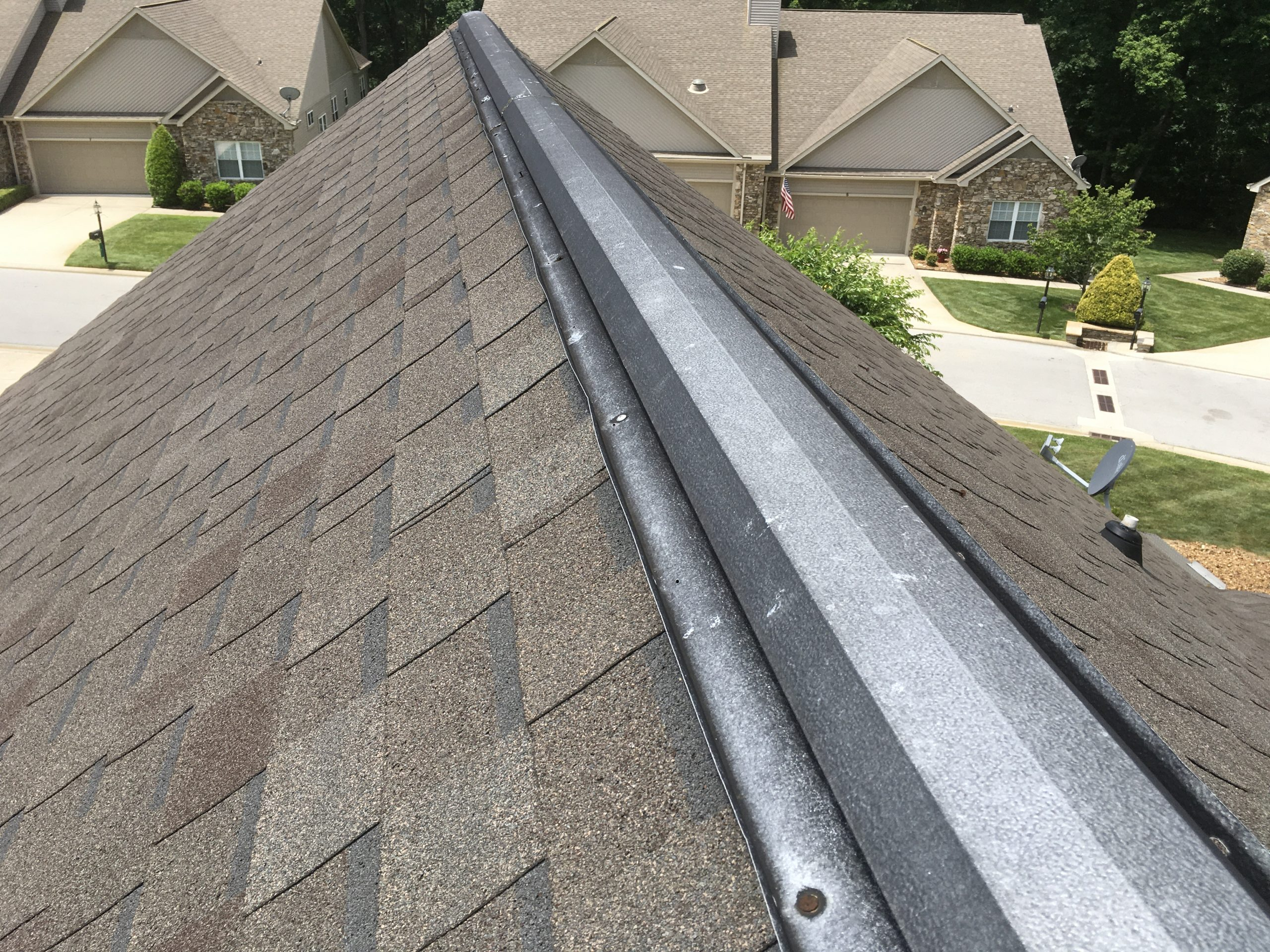 this is a picture of an old metal ridge vent on an old roof in knoxville tn
