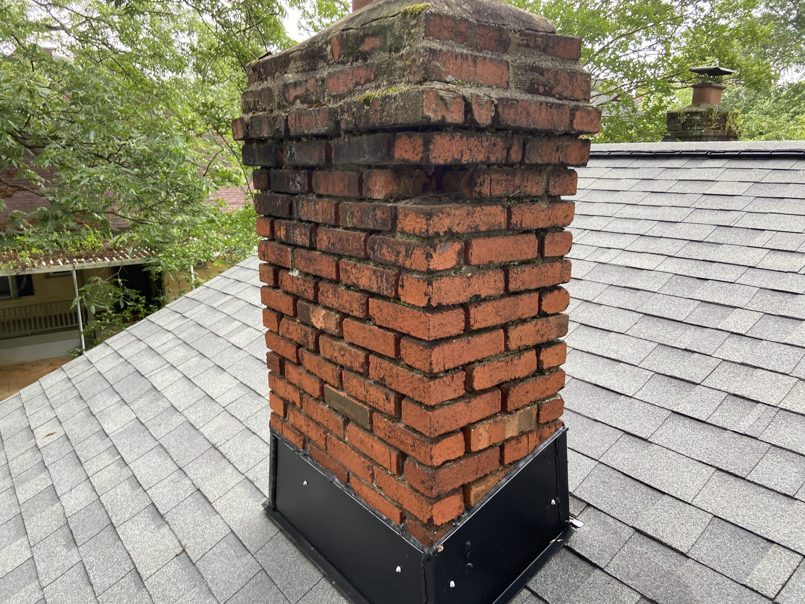 This chimney is in poor shape and Litespeed Construction installed new chimney flashing