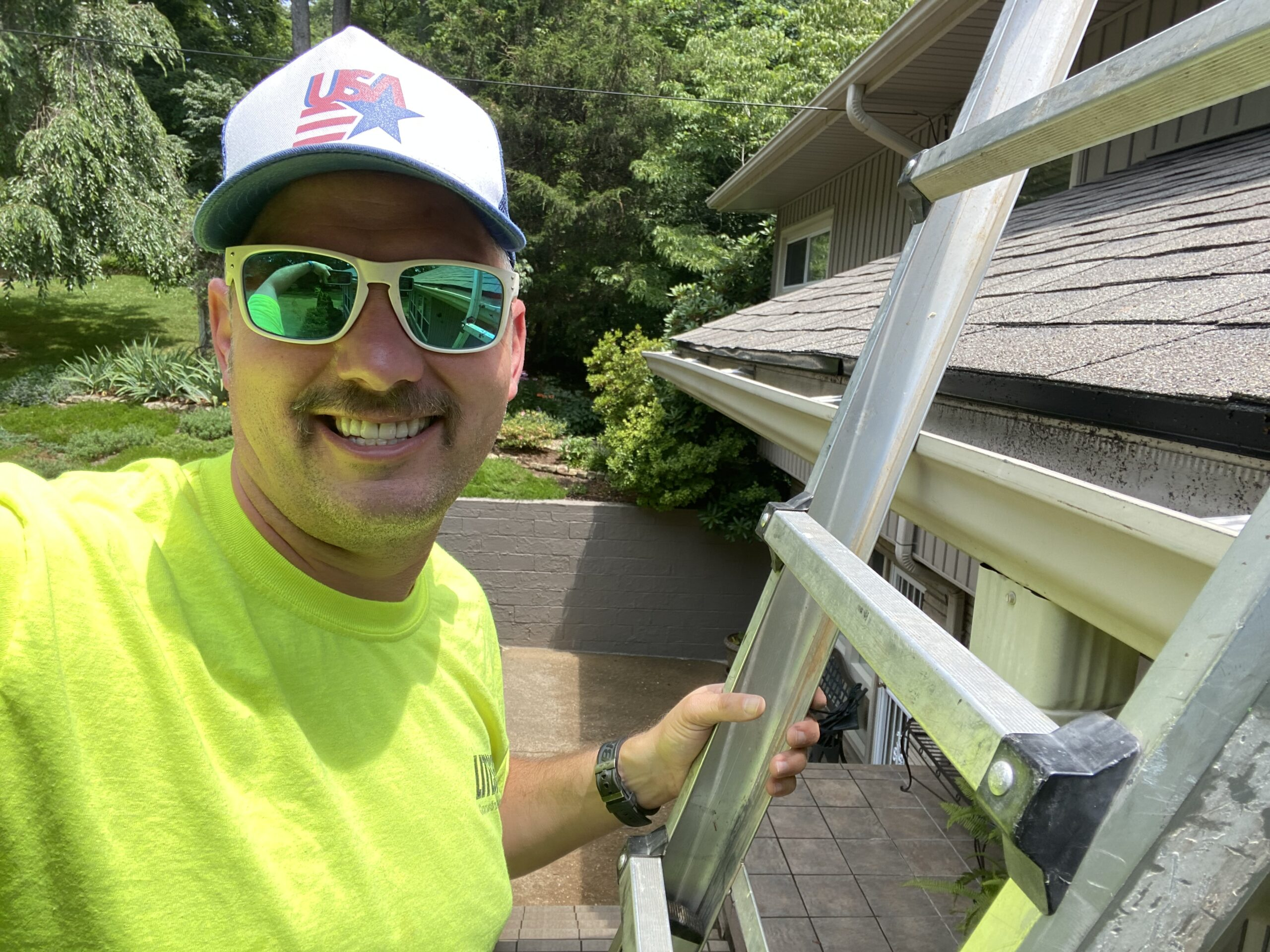 This is a picture of the owner of Litespeed Construction on a ladder.