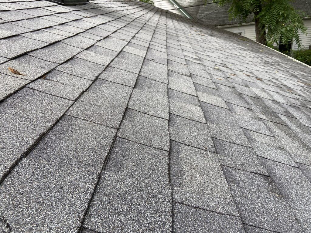 this is a picture of new gray colored shingles showing the straight rows of the shingles we installed