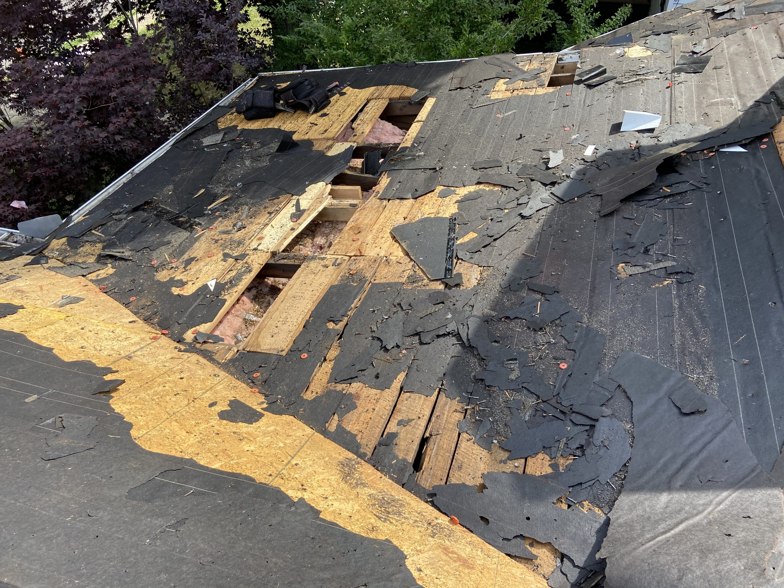 this is a picture showing how bad of condition that the old roof deck was in