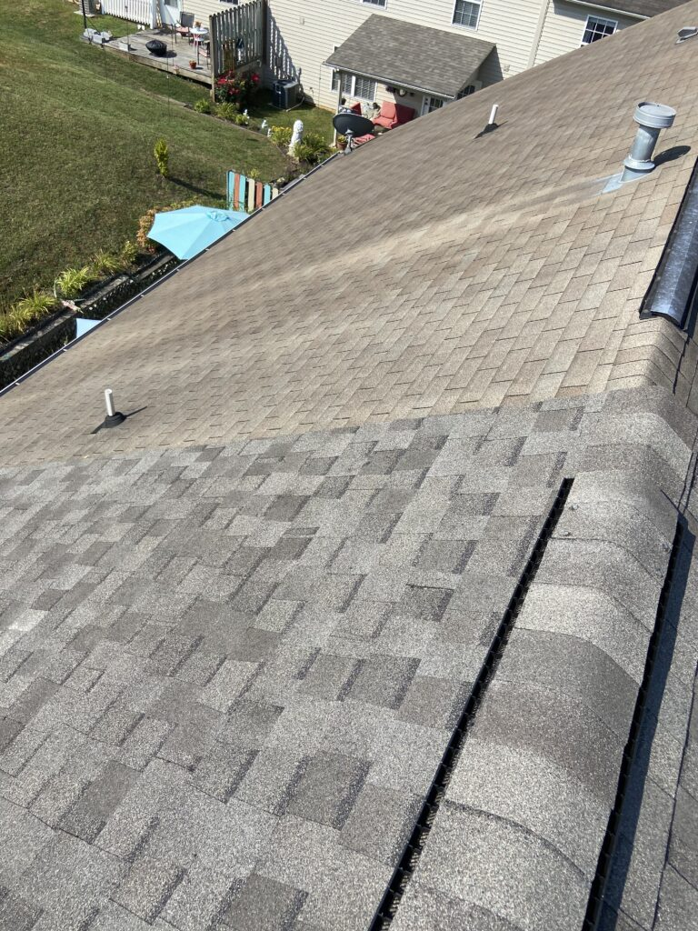this is a picture of an old roof next to a new dimensional shingle that litespeed construction installed in knoxville tn