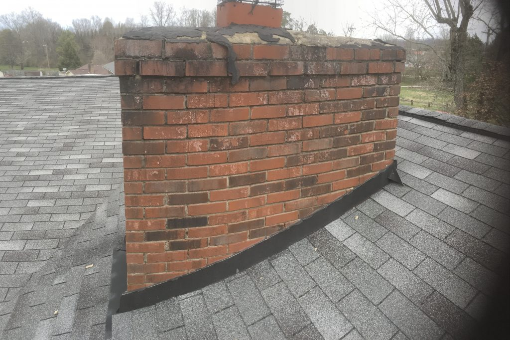 the chimney cap is the cause of this roof leak it is not caused by the shingles or the flashing