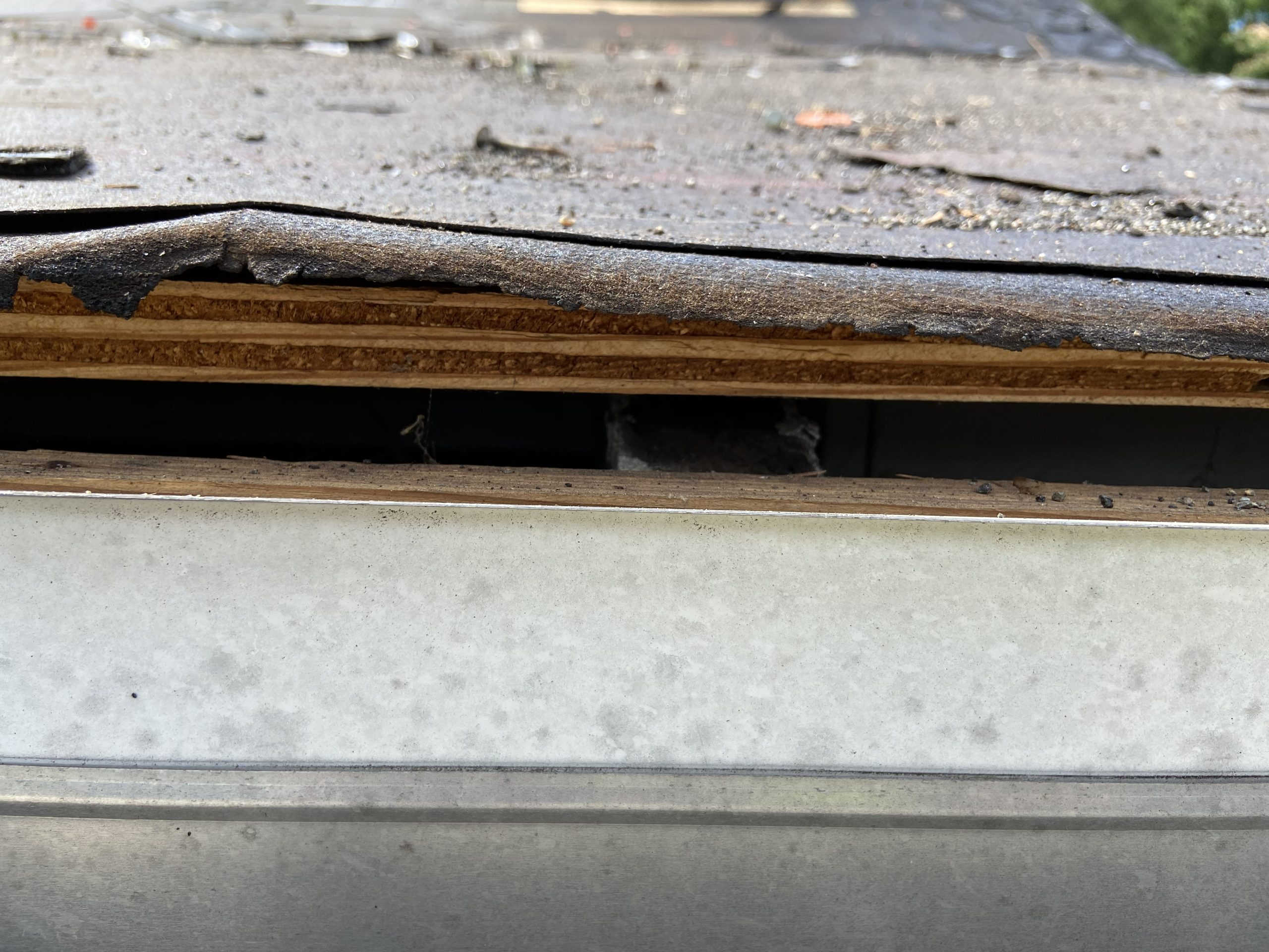 this is a picture of the old roof boards of a shingle roof at the edge of a roof line in knoxville tn