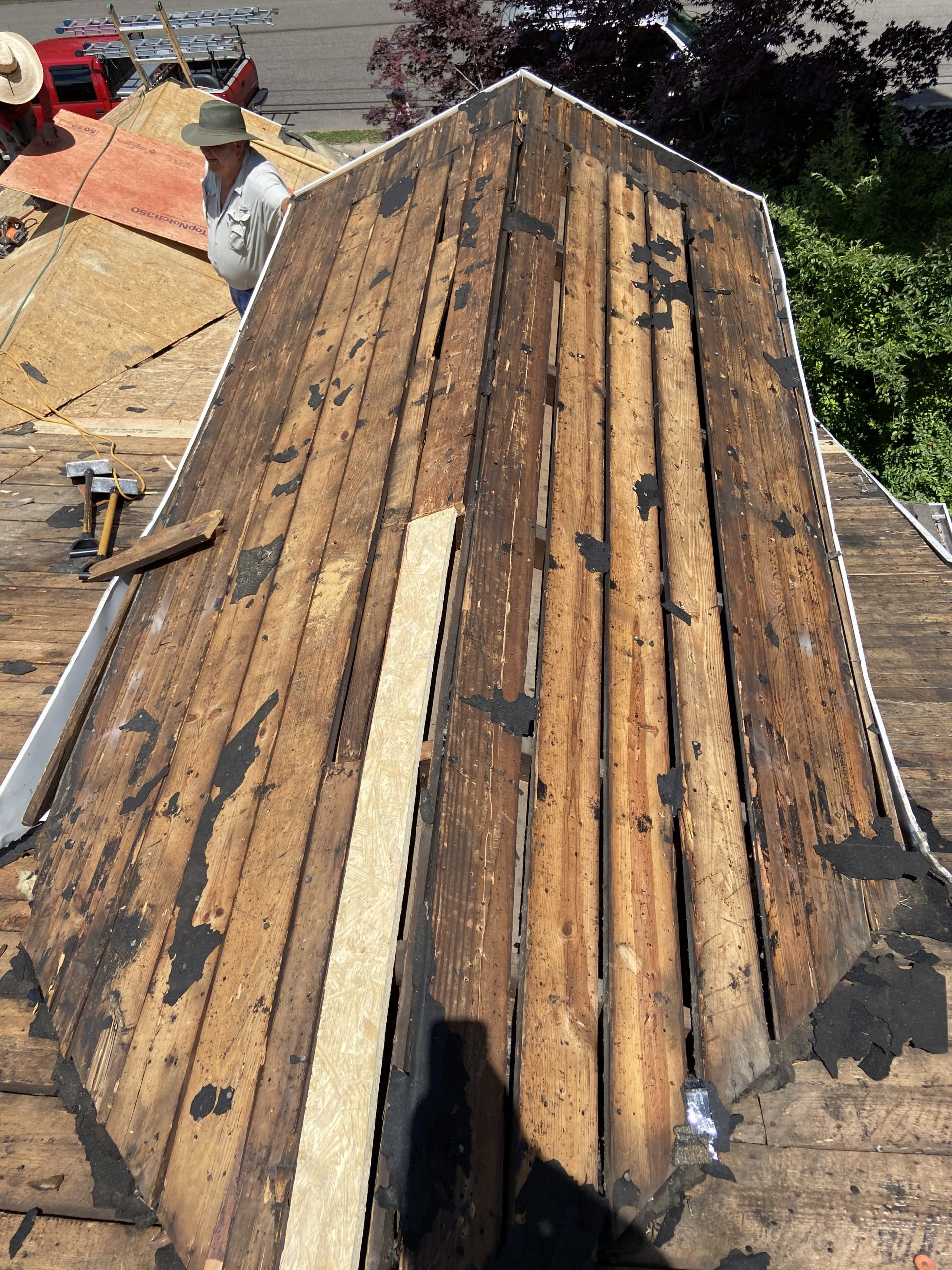 there are big gaps in these old roof deck boards and we put new plywood over this roof in knoxville tn