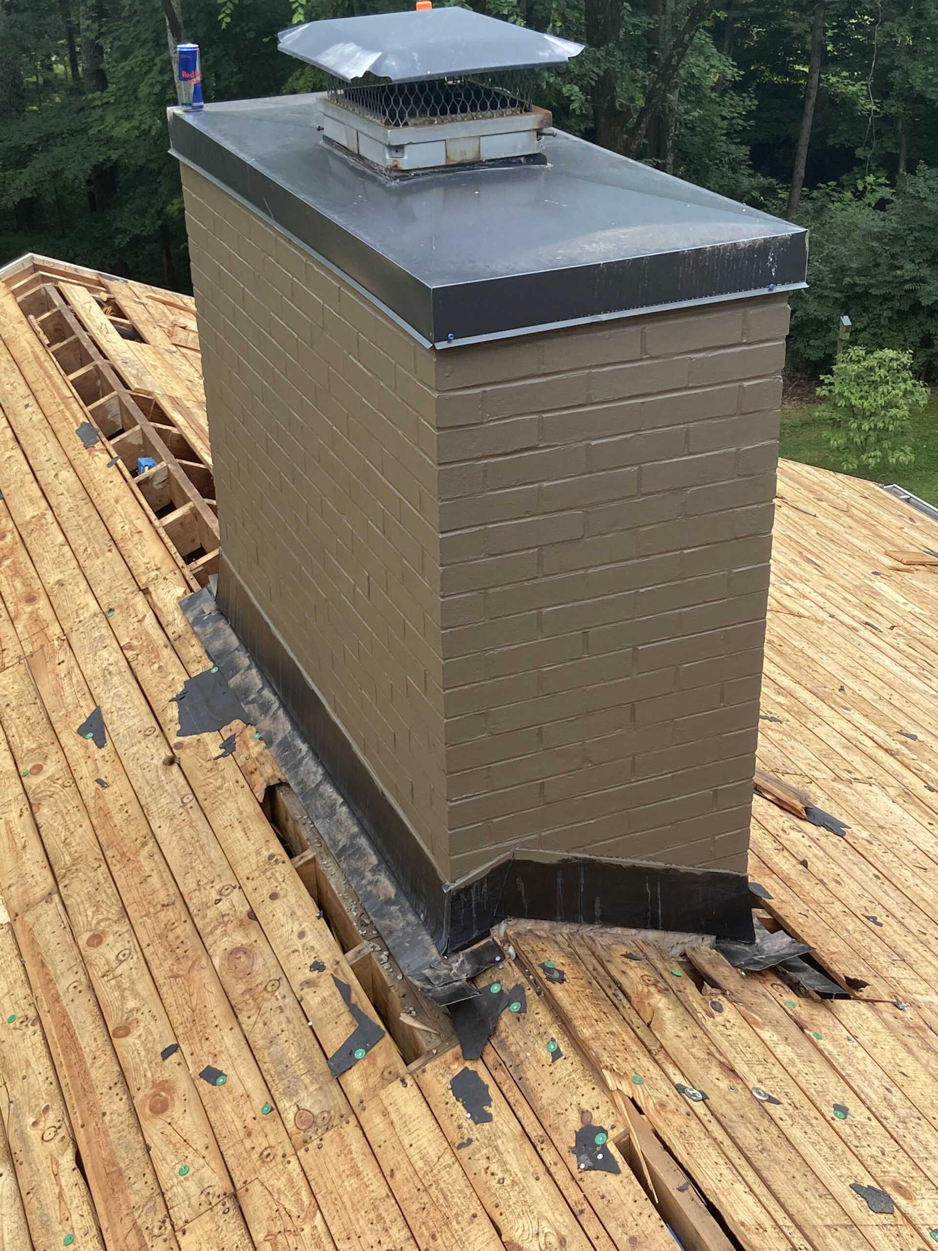 This is the view of the ridge with no shingles and a view of the chimney cap.
