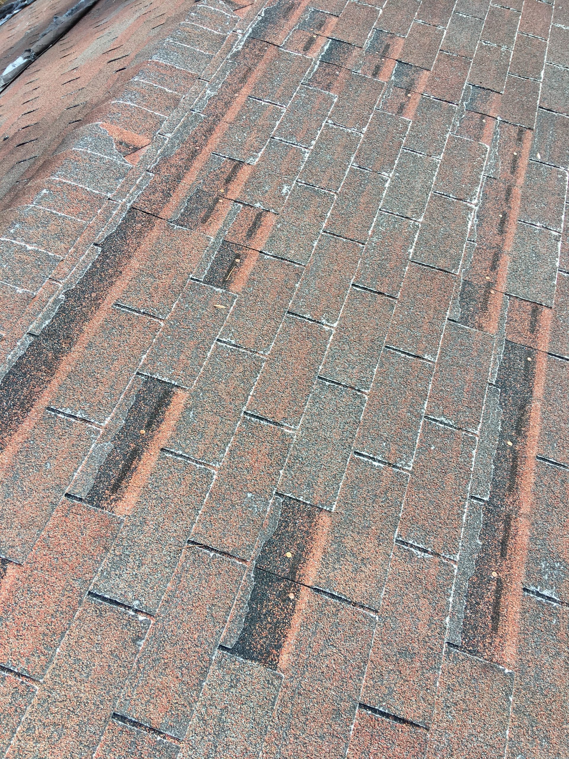 This is an image of shingles at the ridge of the roof.