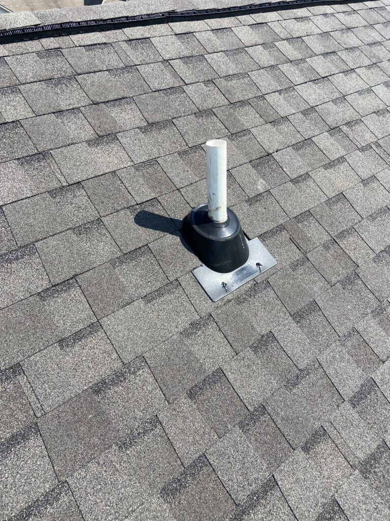 this is a picture of a new pipe boot and tamko heritage weathered wood shingles that were replaced by litespeed construction
