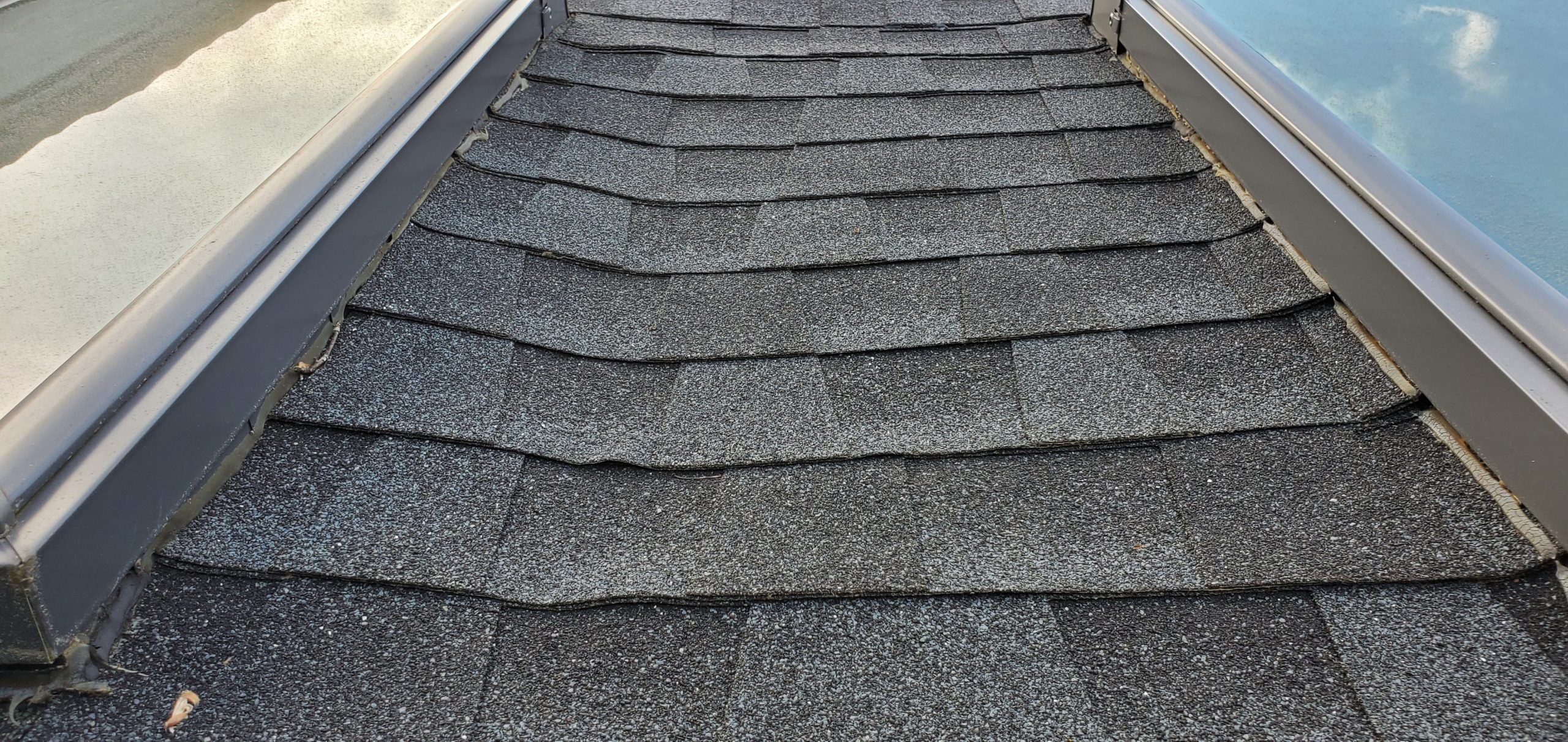 this is a picture of gray colored shingles between 2 skylights in sevierville tn