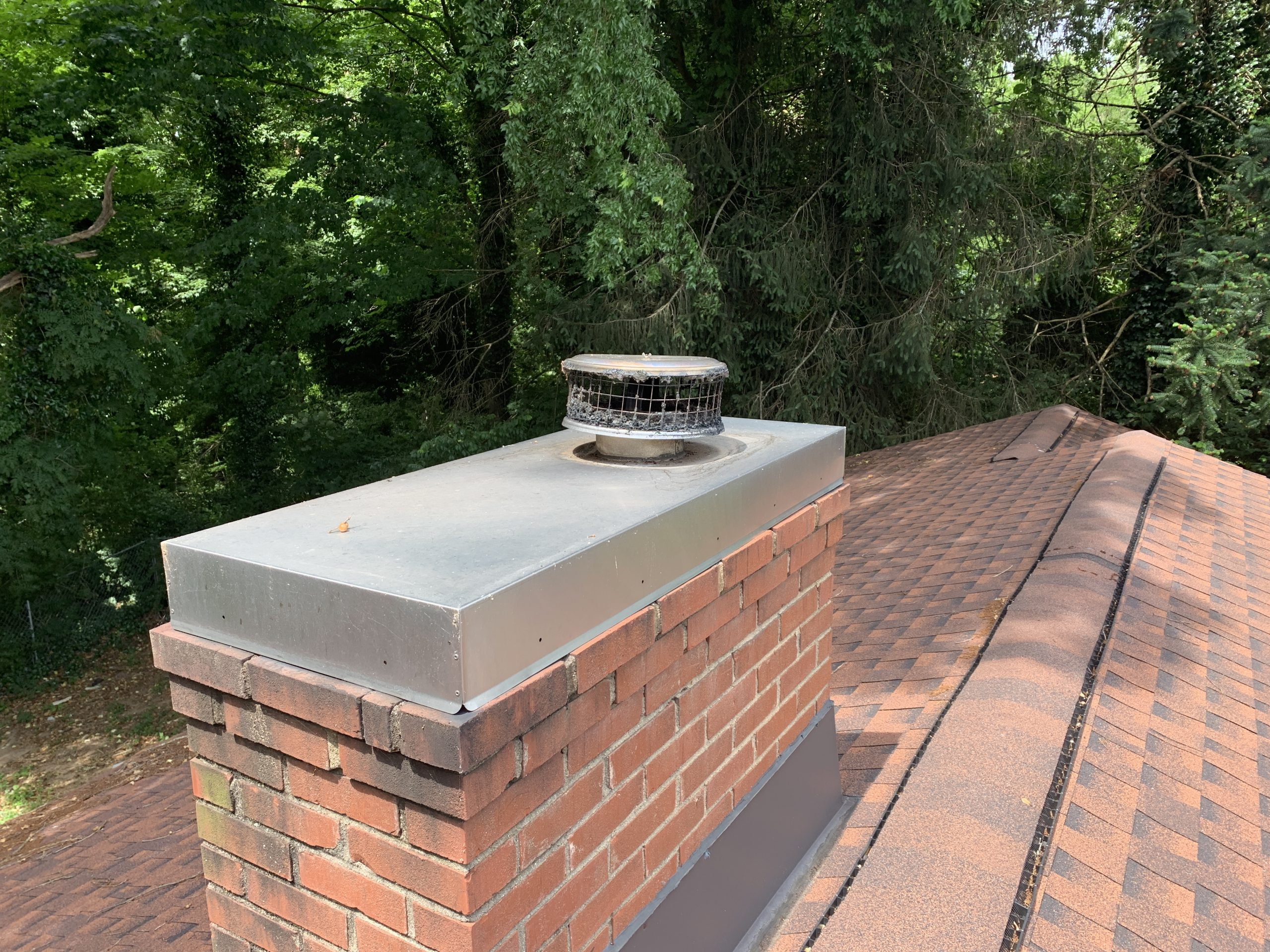 this is a picture of a chimney and chimney cap on roof that litespeed construction recently replaced