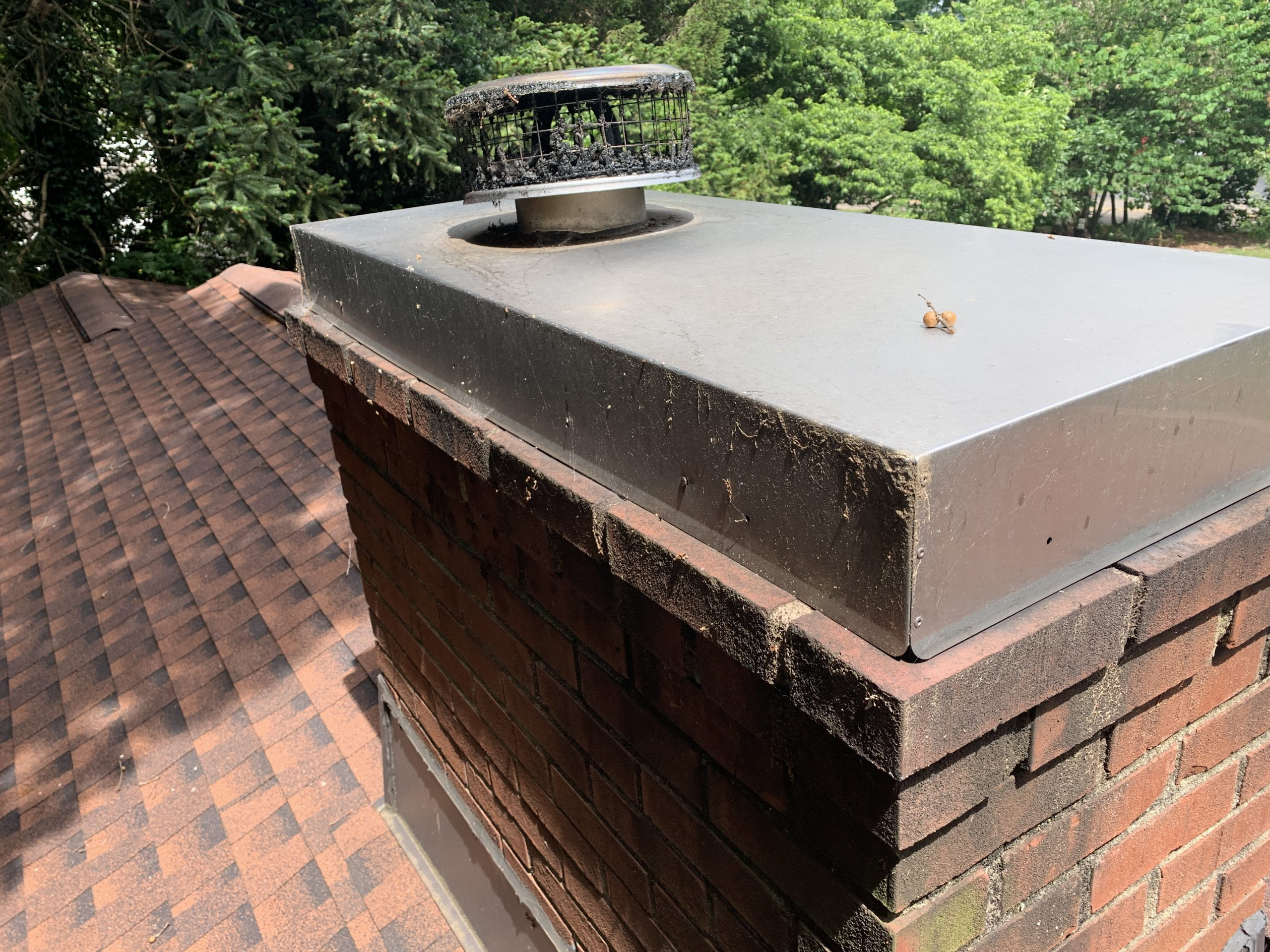 this is a picture of the chimney cap on a roof that litespeed construction recently replaced in knoxville tn