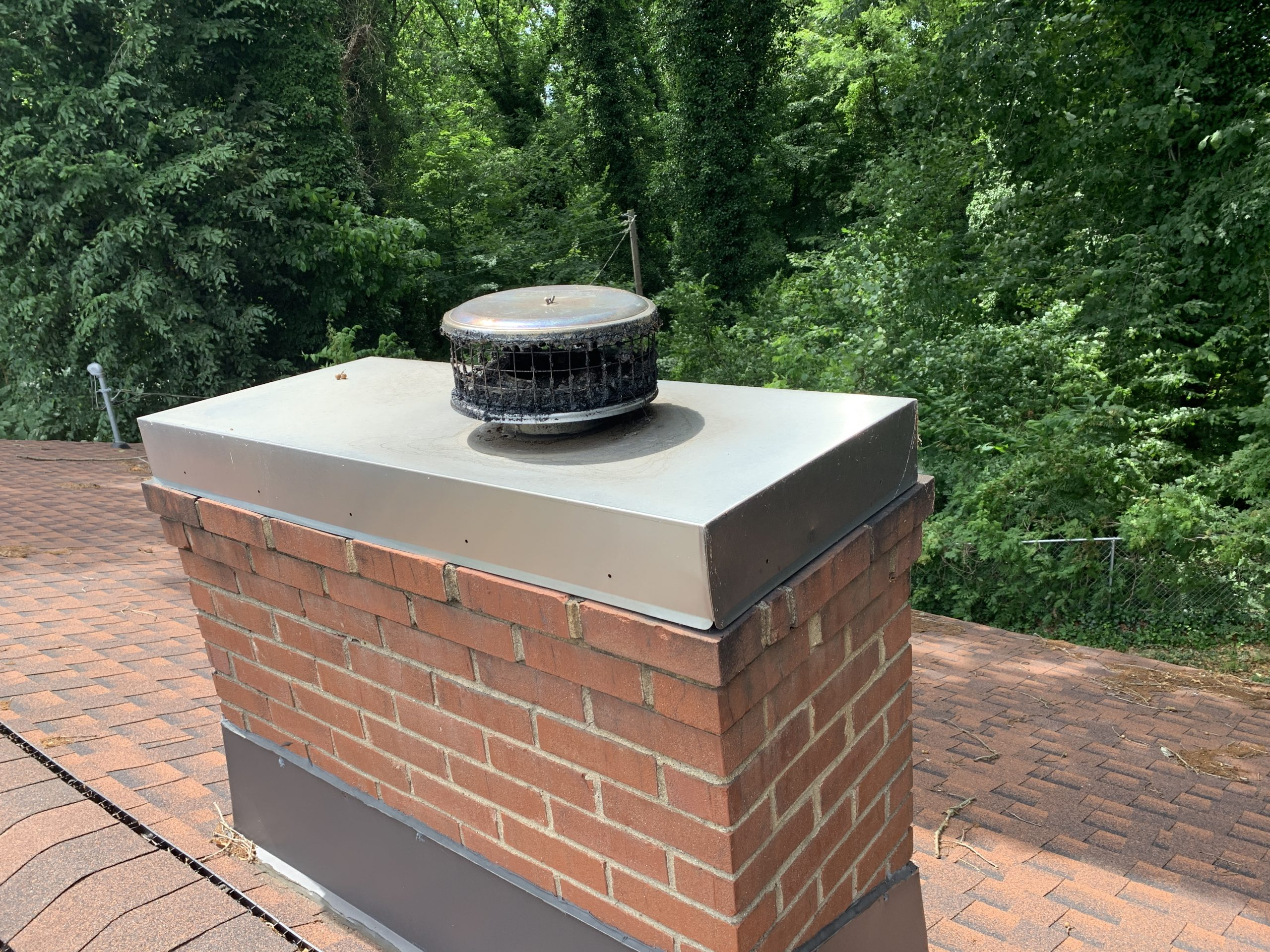 this is a picture of chimney flashing that litespeed construction installed on a new roof in knoxville tn