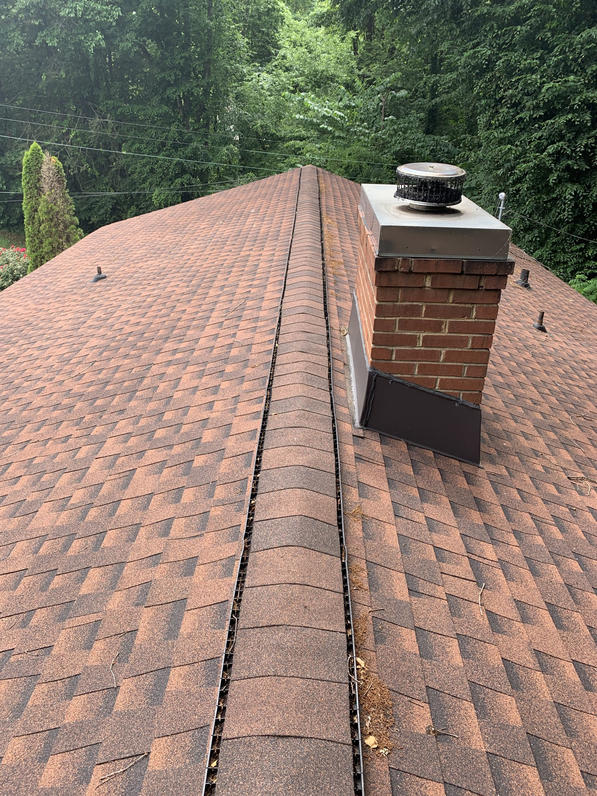 this is a picture of a roof that has new gaf timberine hickory colored shingles