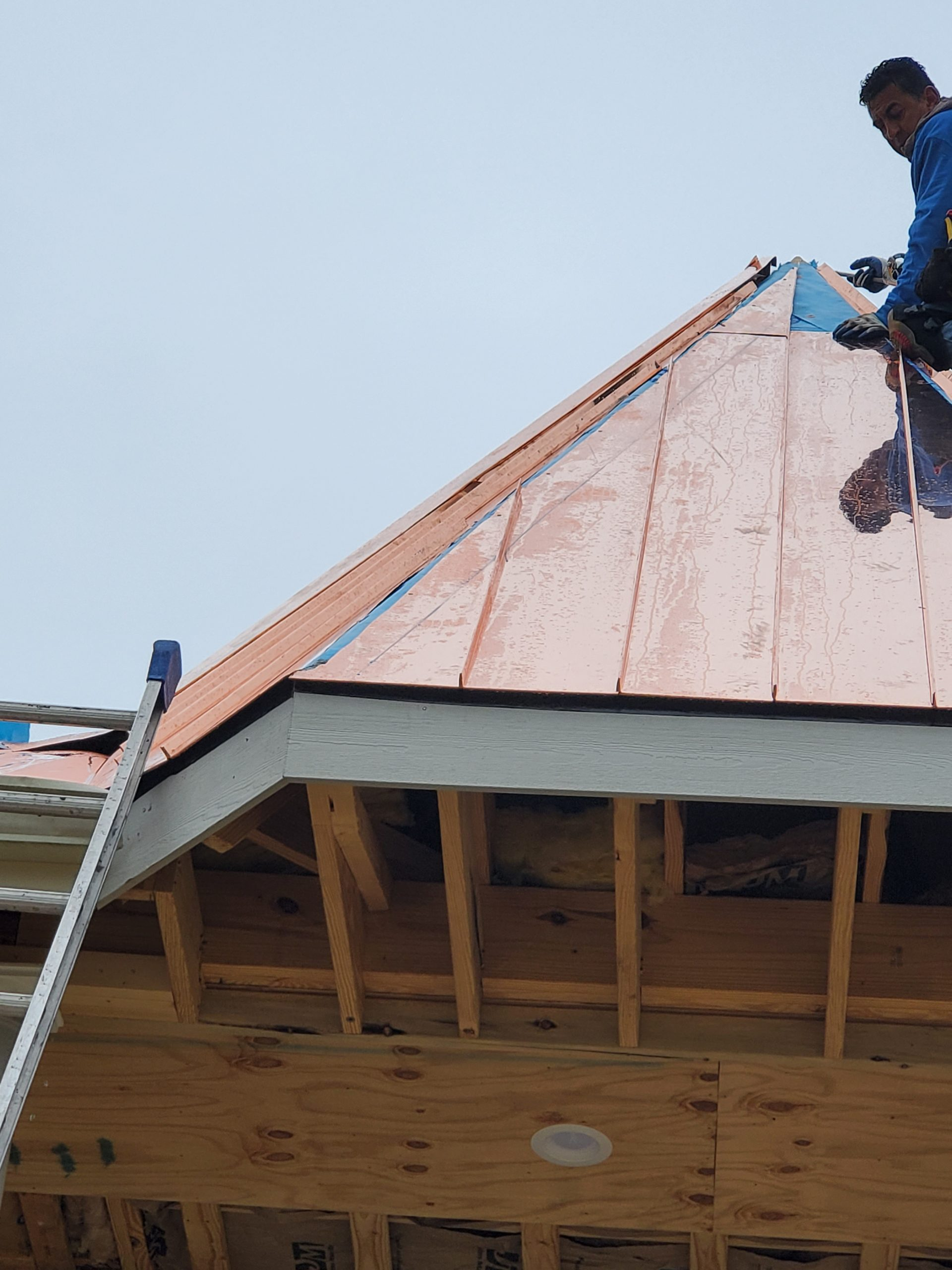 this is a picture of copper roof getting installed on a cupola