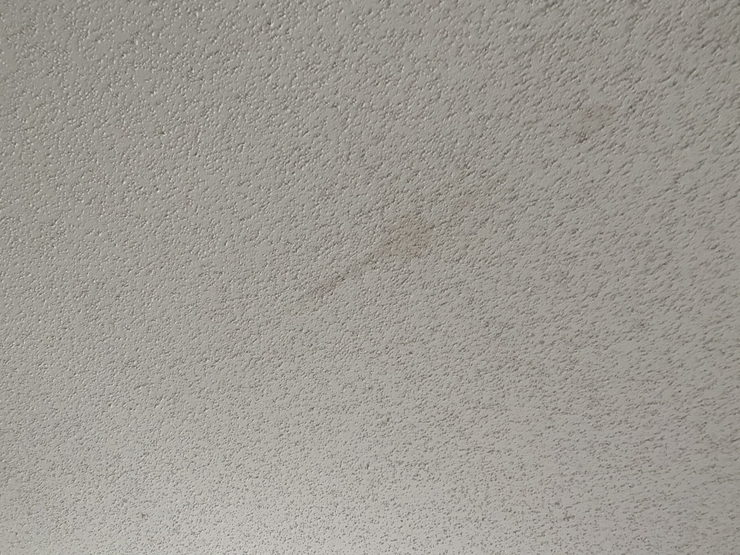 here is a ceiling stain in the hallway of this home