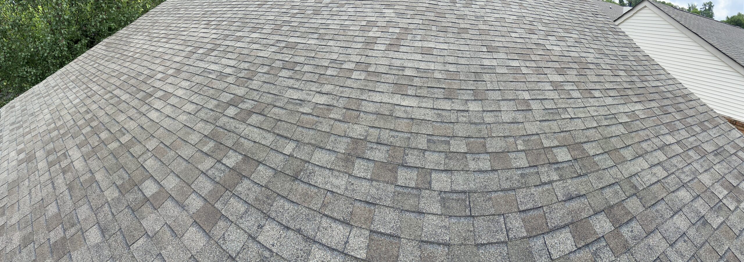 this is a picture of a weathered wood colored shingle that has lots of blistering and cracking