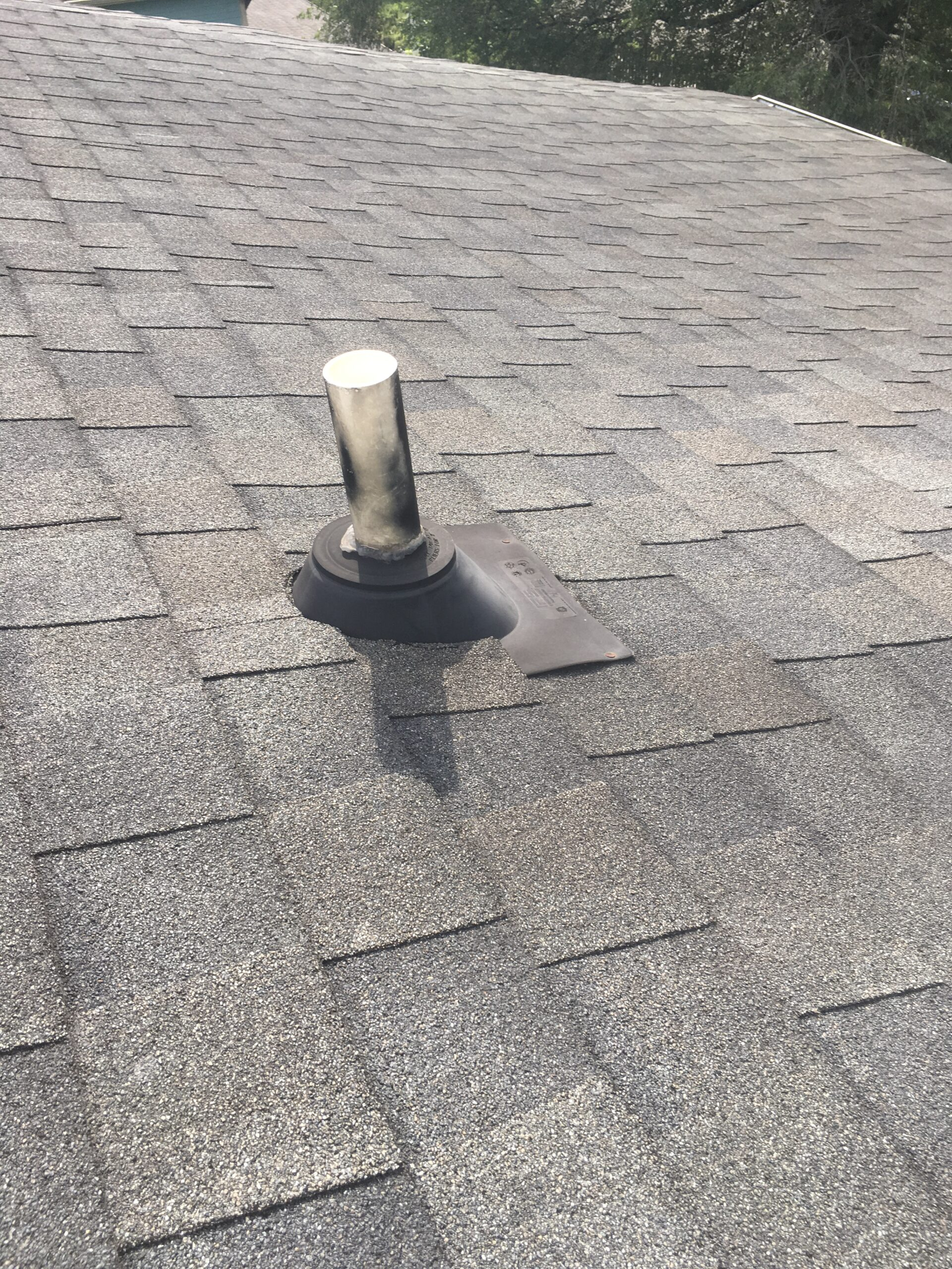 This is a picture of a pipe boot on a section of roof that will get solar panels