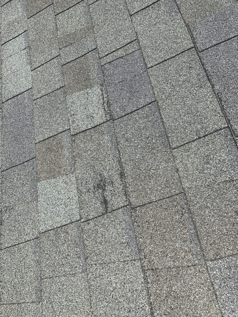 damaged creased shingles