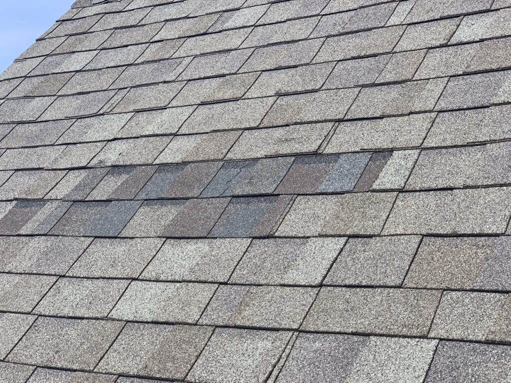 this is a picture of a replacement shingle on a roof