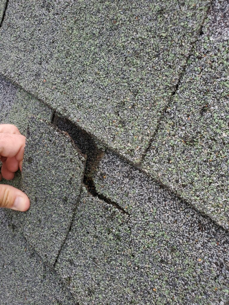 This is a picture of a broken shingle.