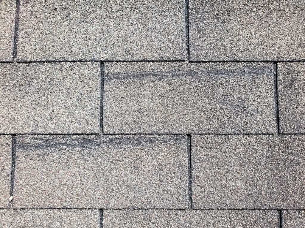 this is a picture of old shingles with creases in them