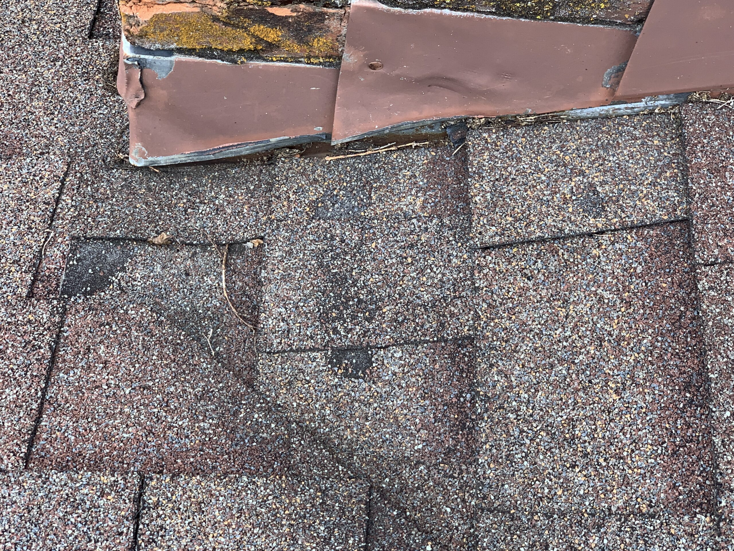 chimney flashing is in very bad shape and needs to be replaced on this roof