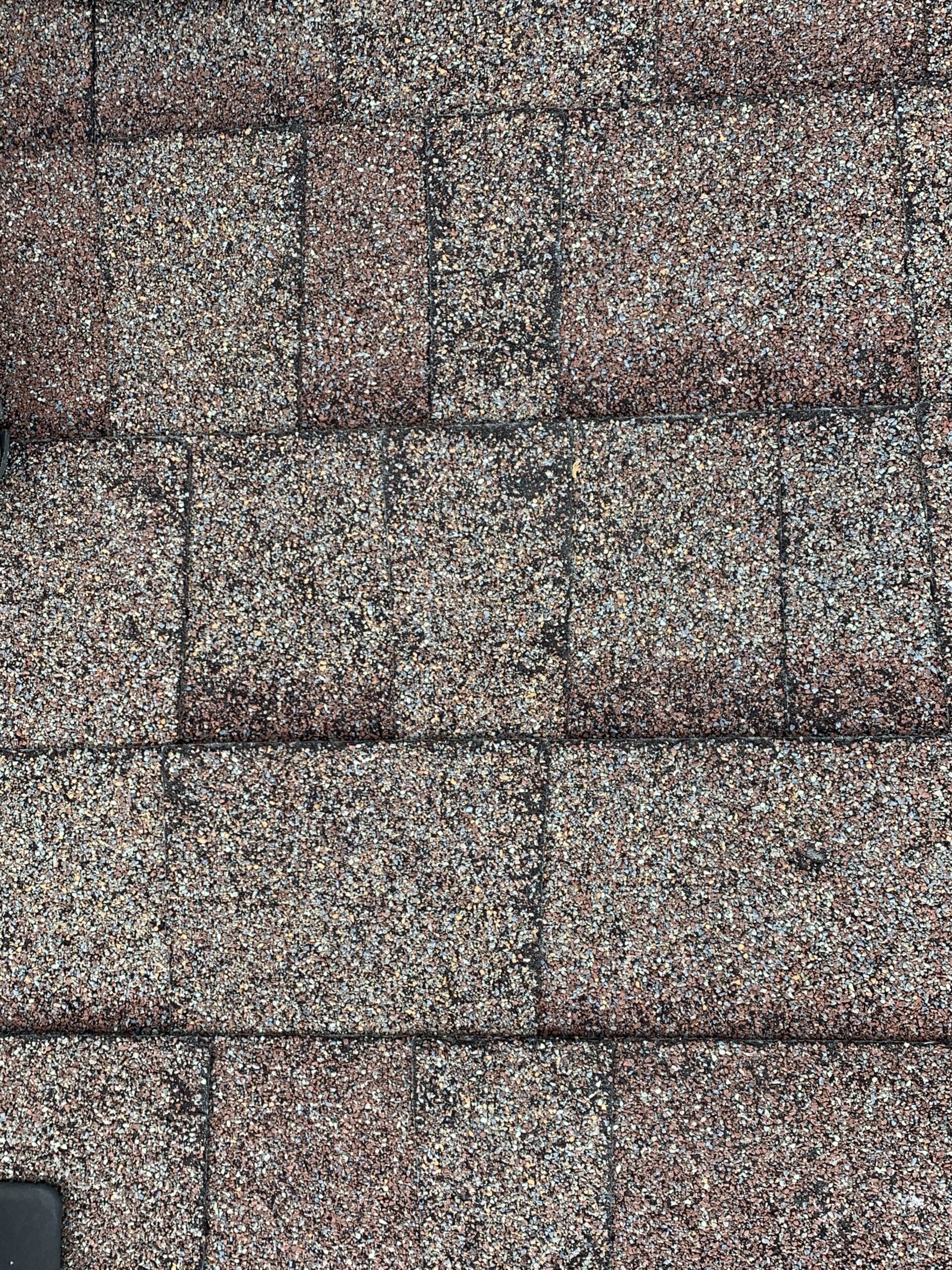 some hail damages to this gray dimensional shingles