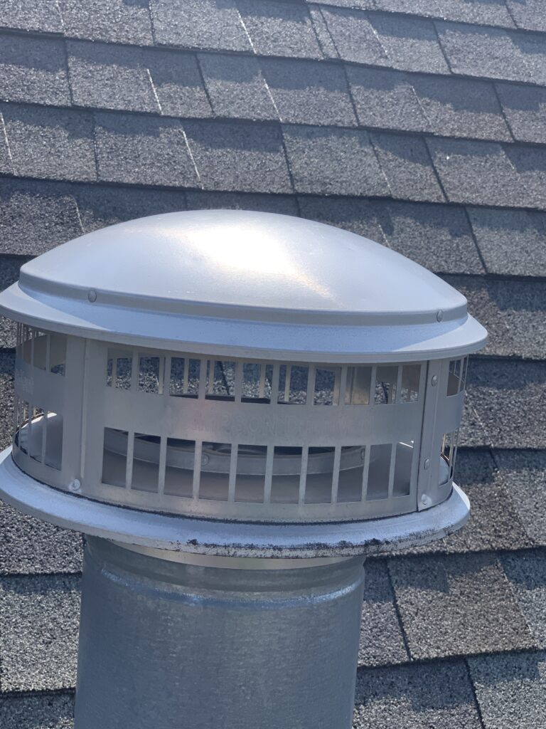 this is a metal cap on an exhaust of a roof