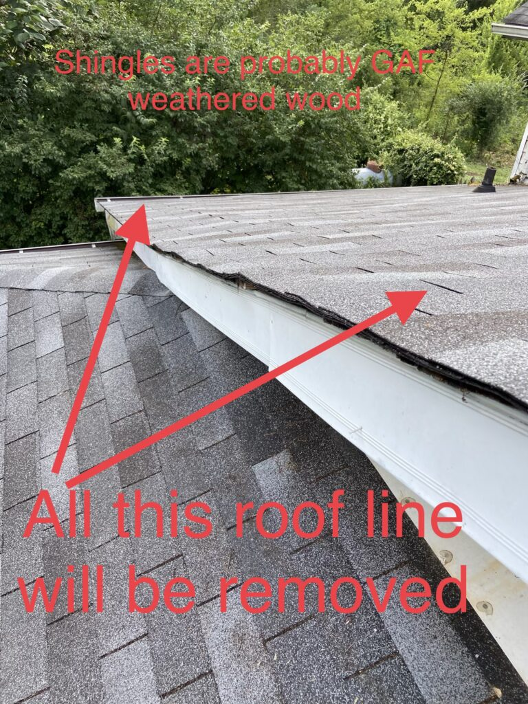 this is a picture of the roof slope mentioning via text in the photo that this entire roof line will need to be removed