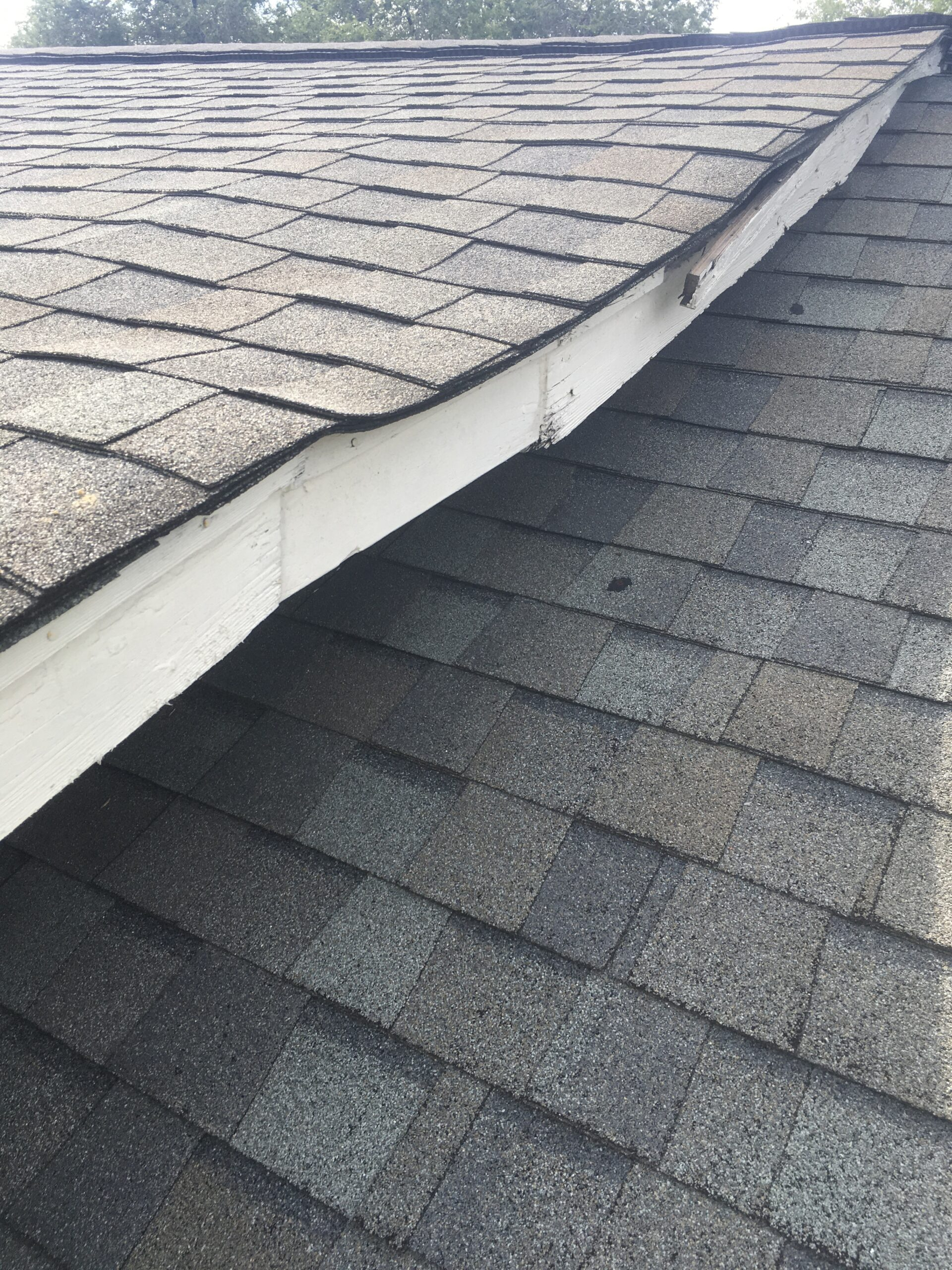 this is a picture of a damaged soffit of a roof that is falling