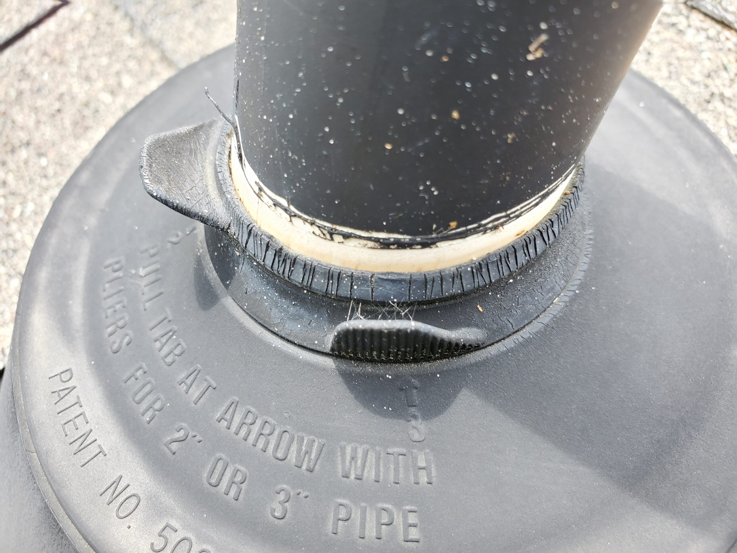 this is a picture of a plastic pipe boot on an old roof