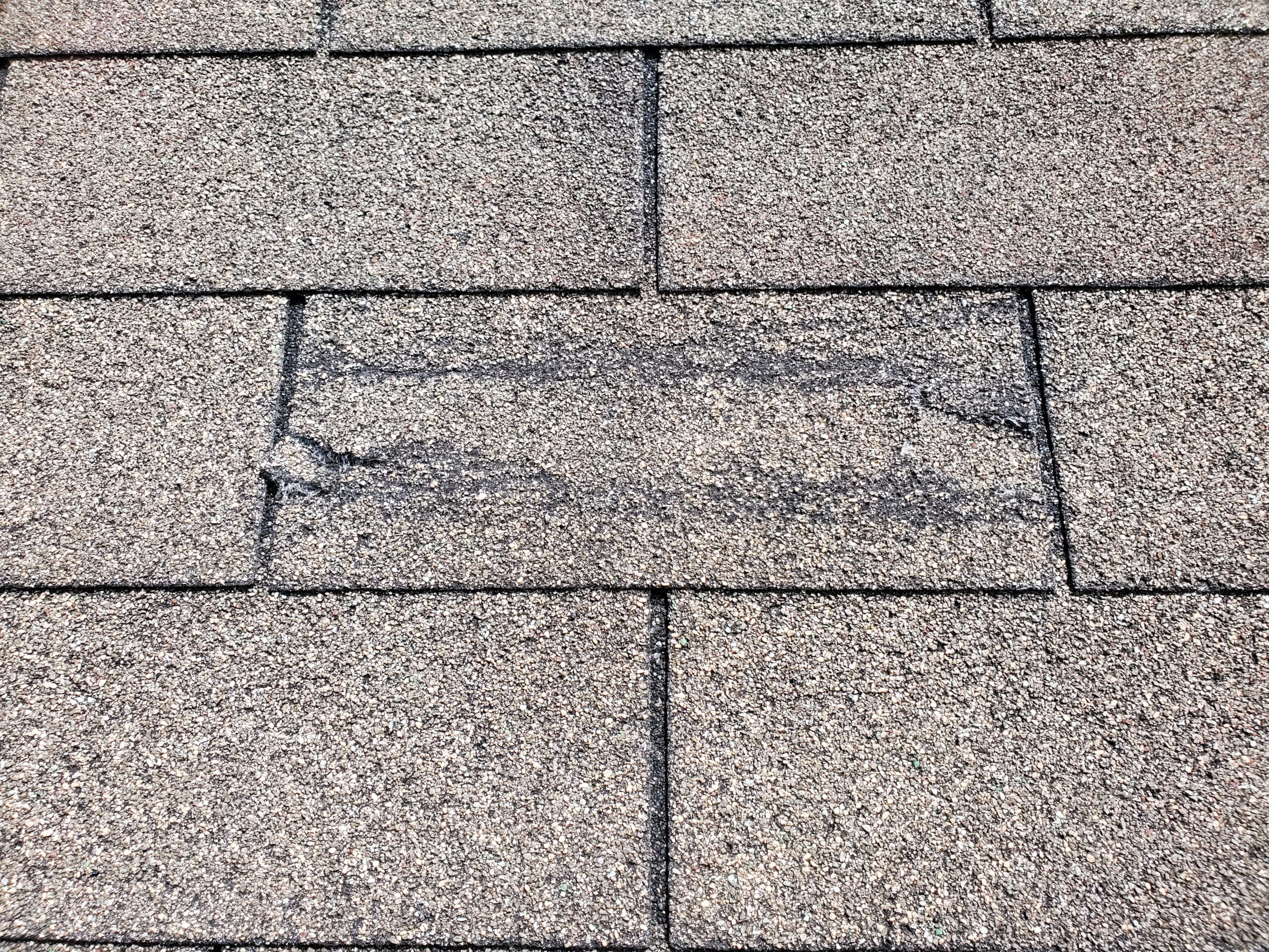 this is a picture of wind creased shingles on this roof