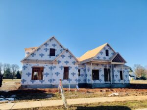 Building Contractor Picture Of New Home Under Construction