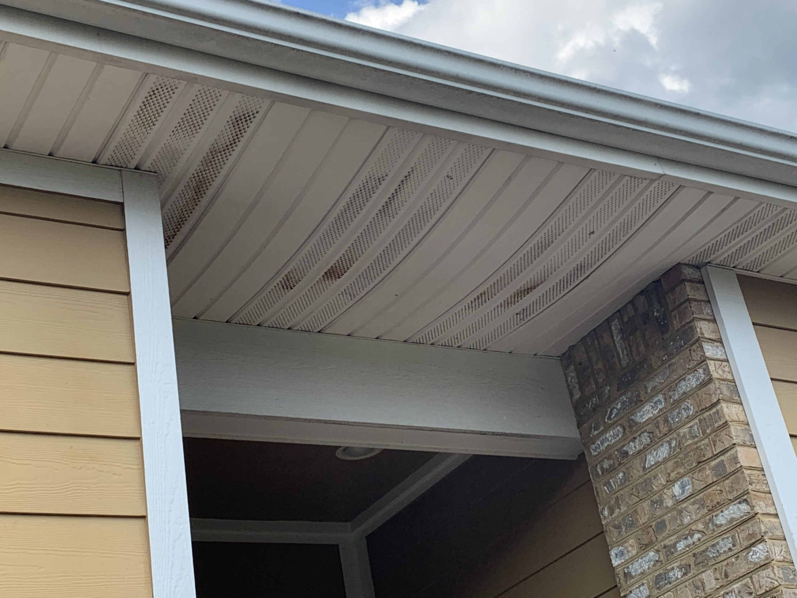this is a picture of the vented soffit and white gutters for this home