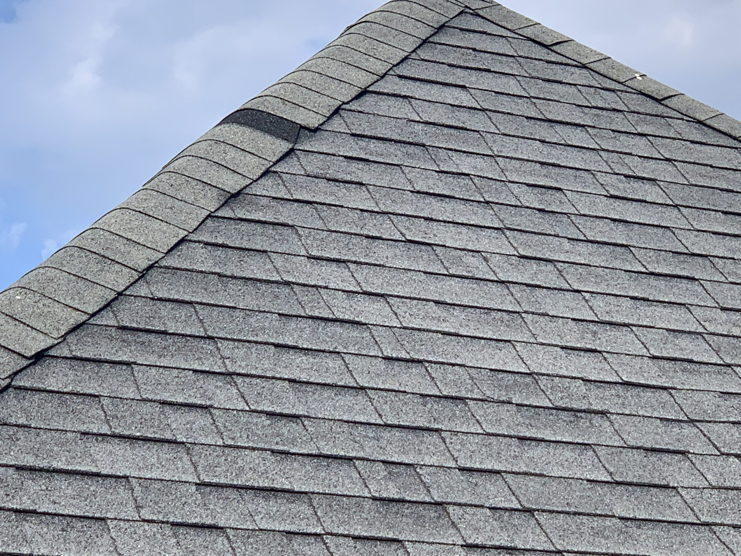 this is a picture of a missing shingle on the peak of a roof