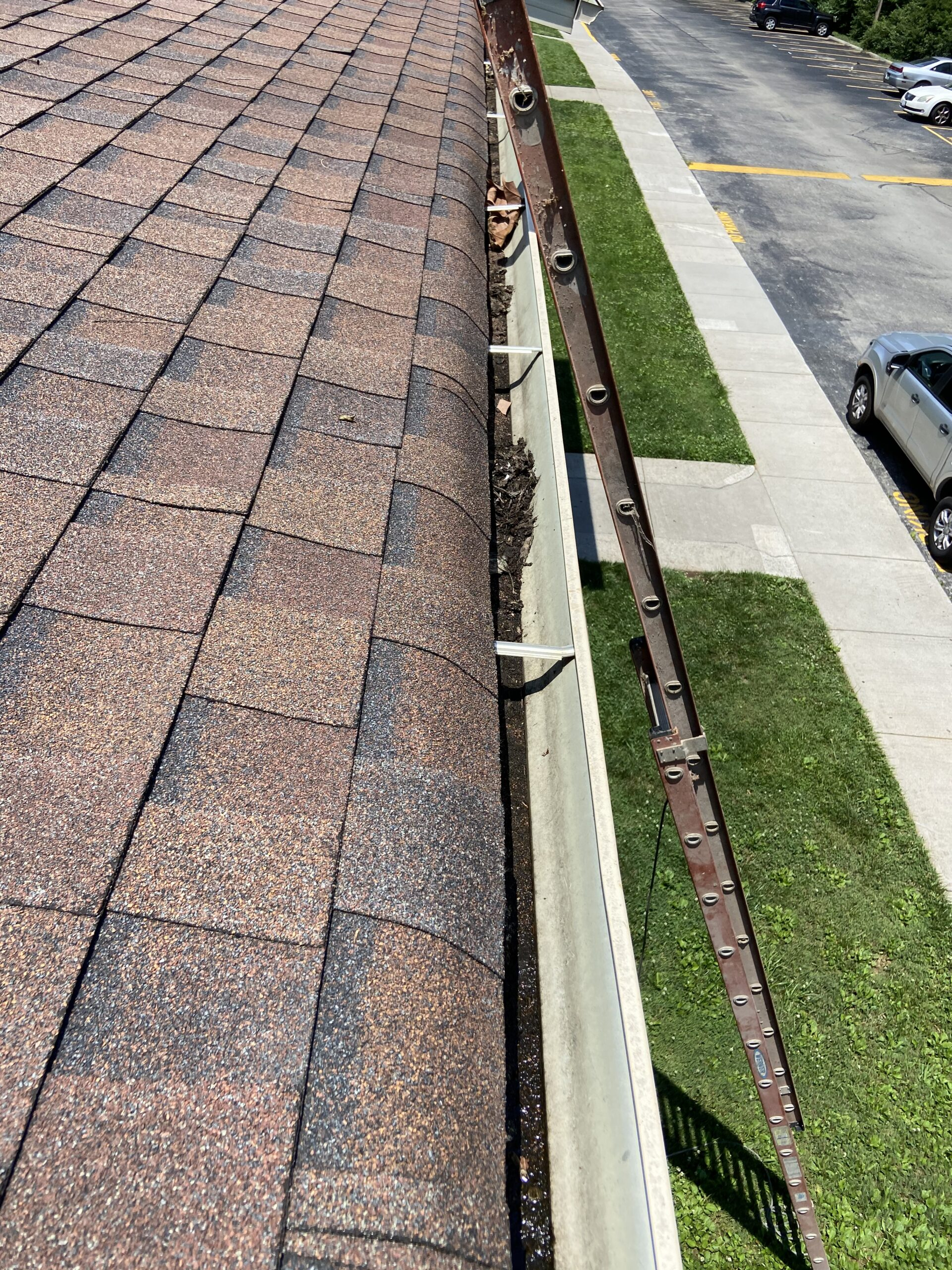 THis is a picture of gutters that have debris in them