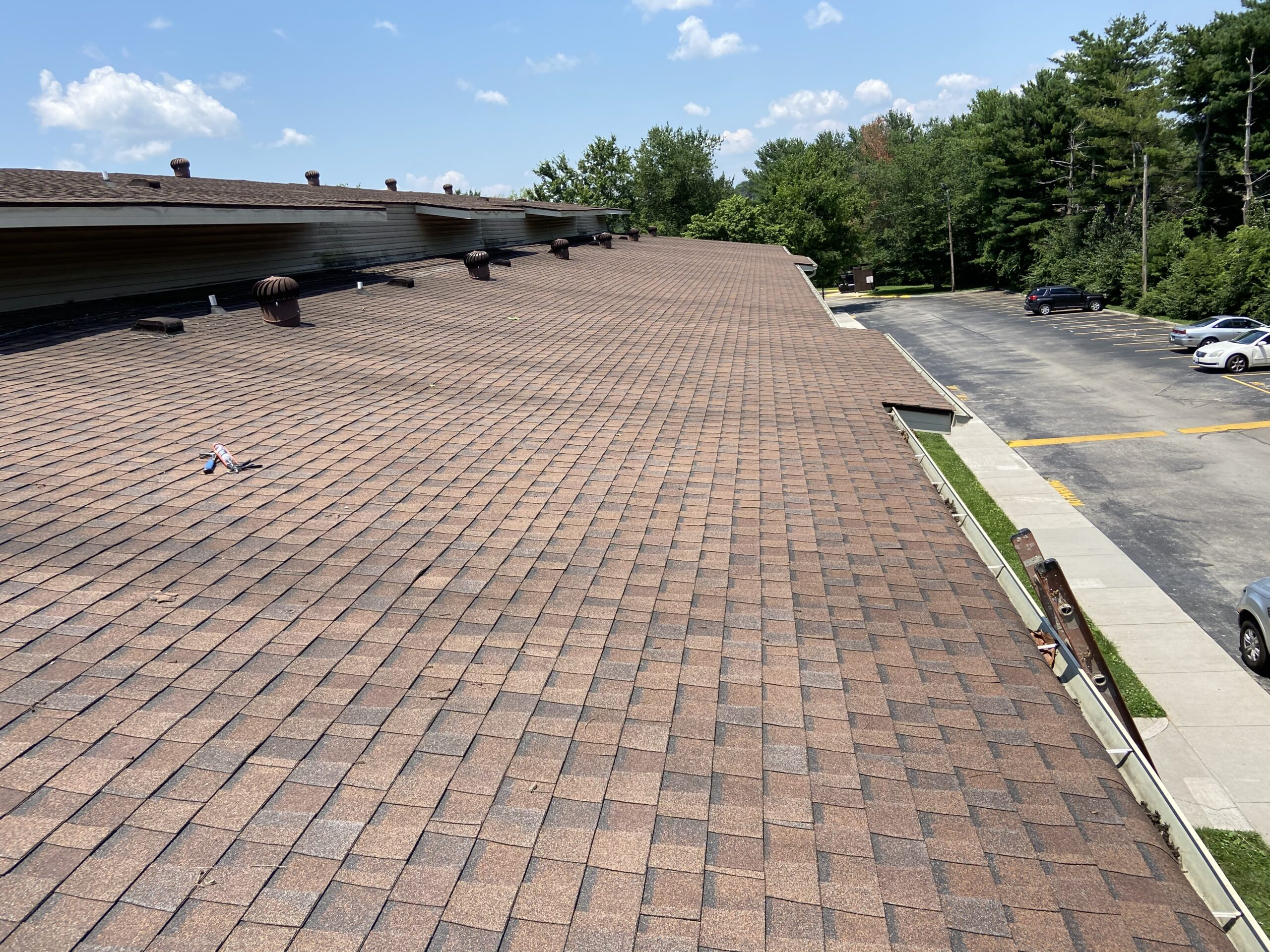 this is a picture of brown shingles on an apartment complex roof