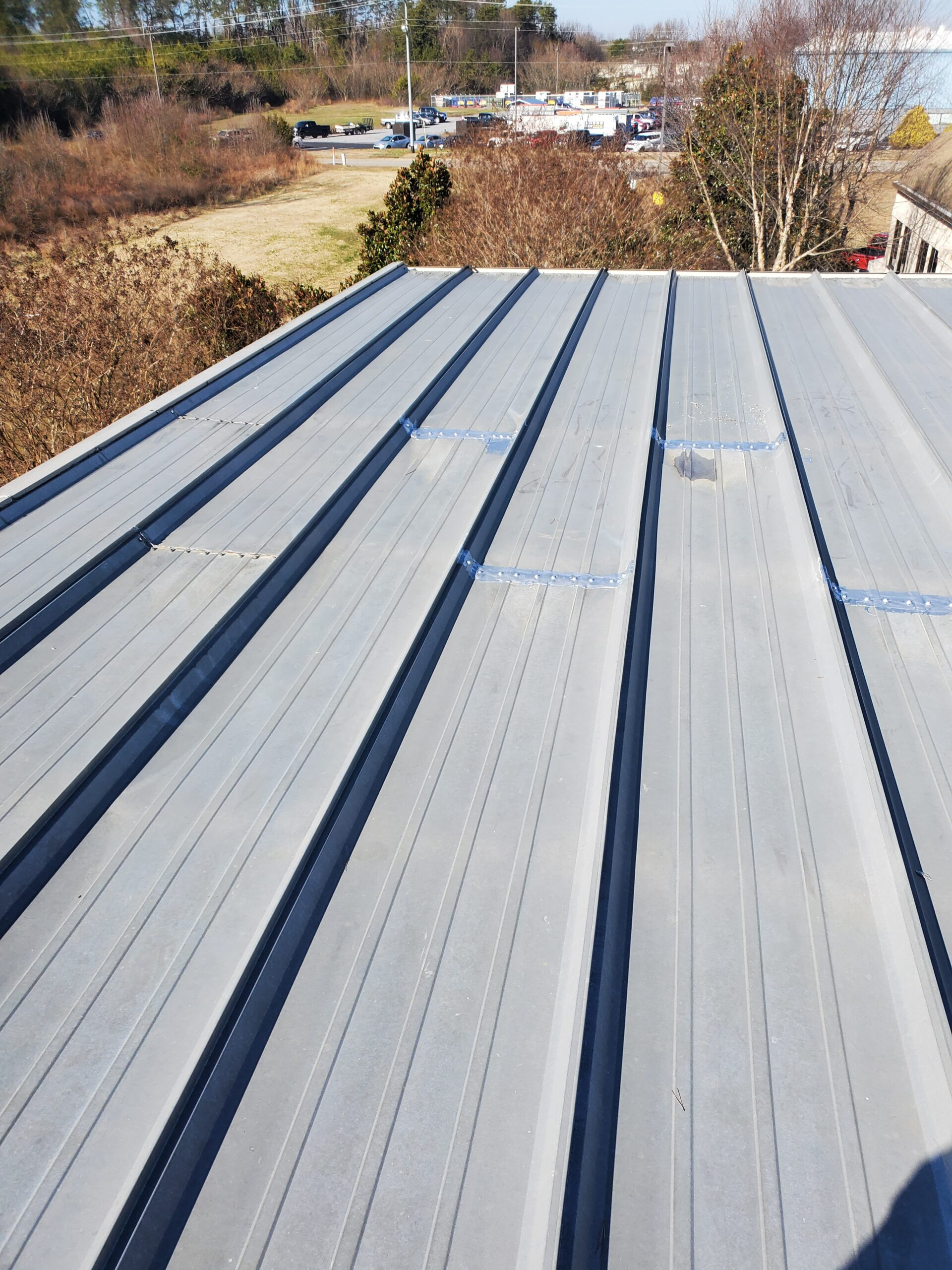 metal roof with some of the coating to exposed screws