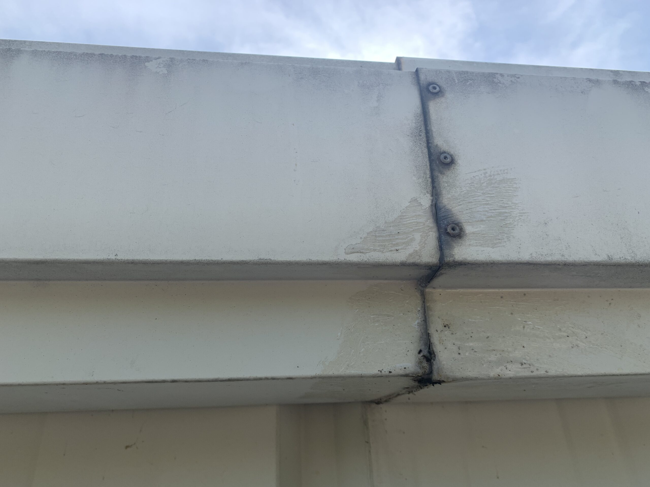 this is a picture of commercial gutters that appear to be leaking