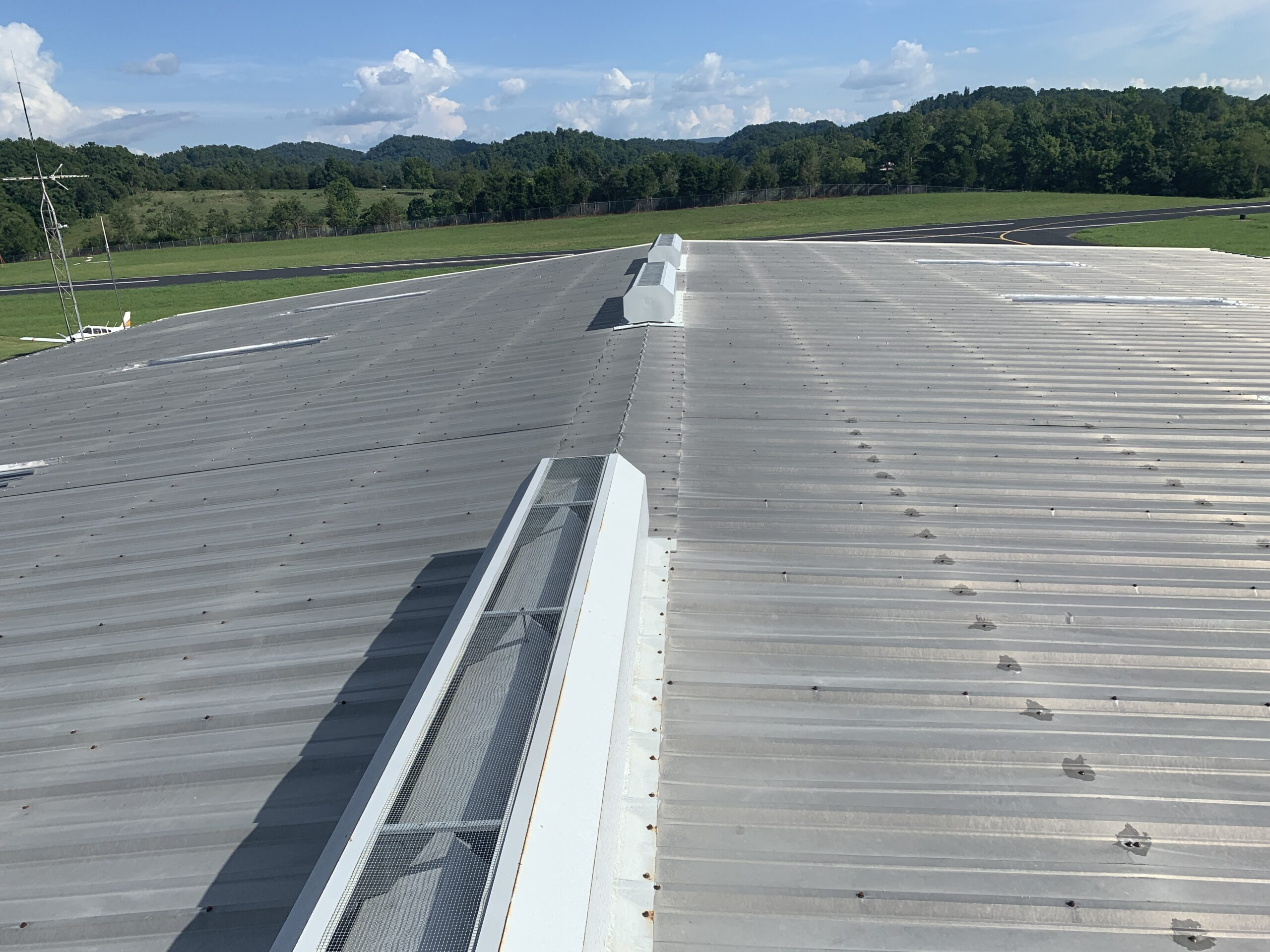 this is a picture of the metal roof and the vents in the top of the metal roof and the skylights in the metal roof