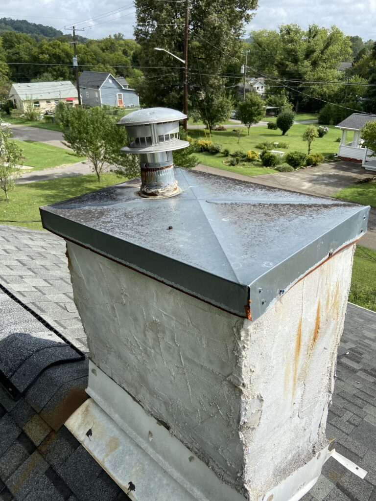 Rusty Metal chimney cap that needs to be replaced