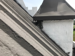 roof coating at a dormer