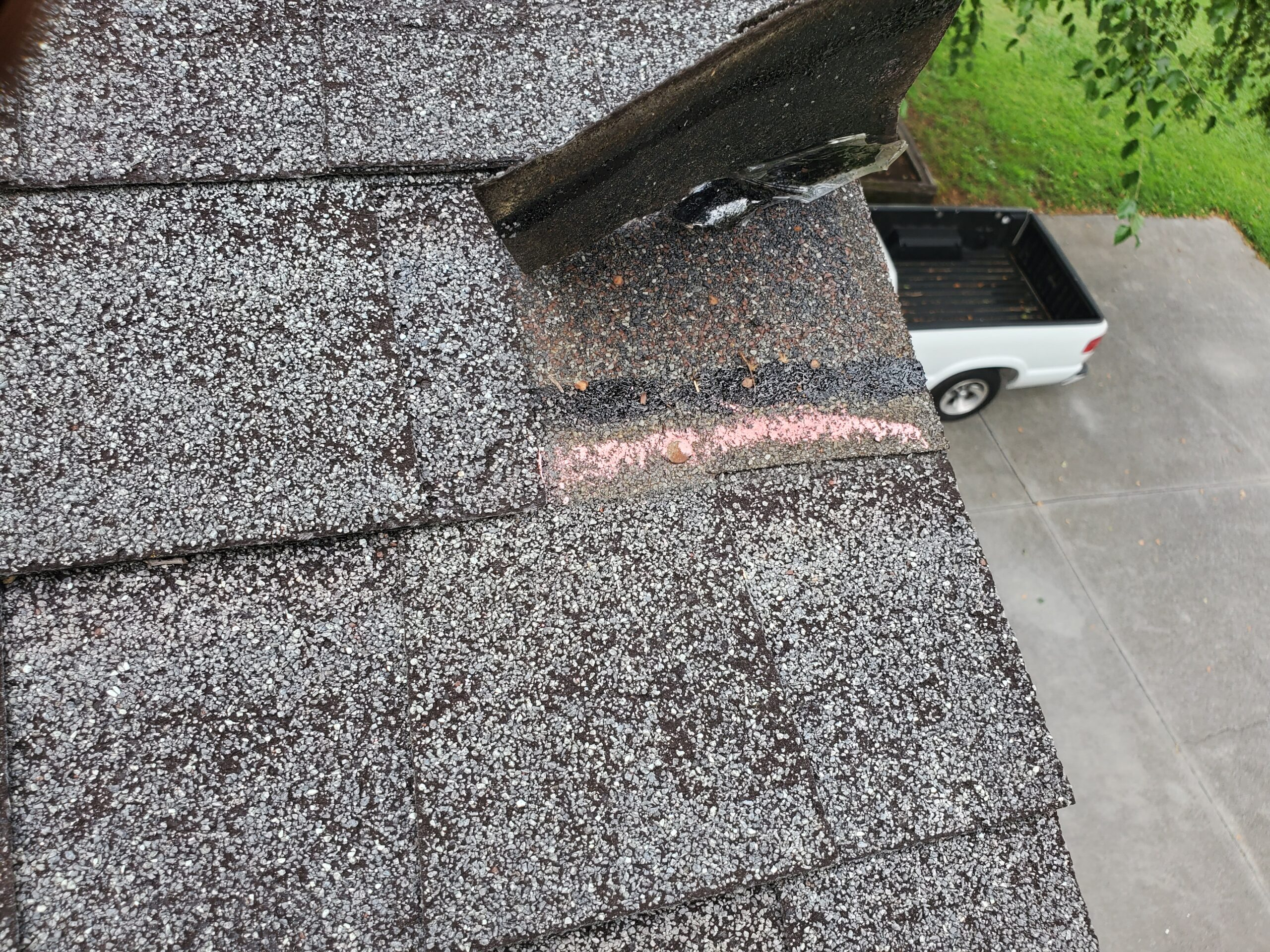 this is a shingle on the edge of a roof that is blown off