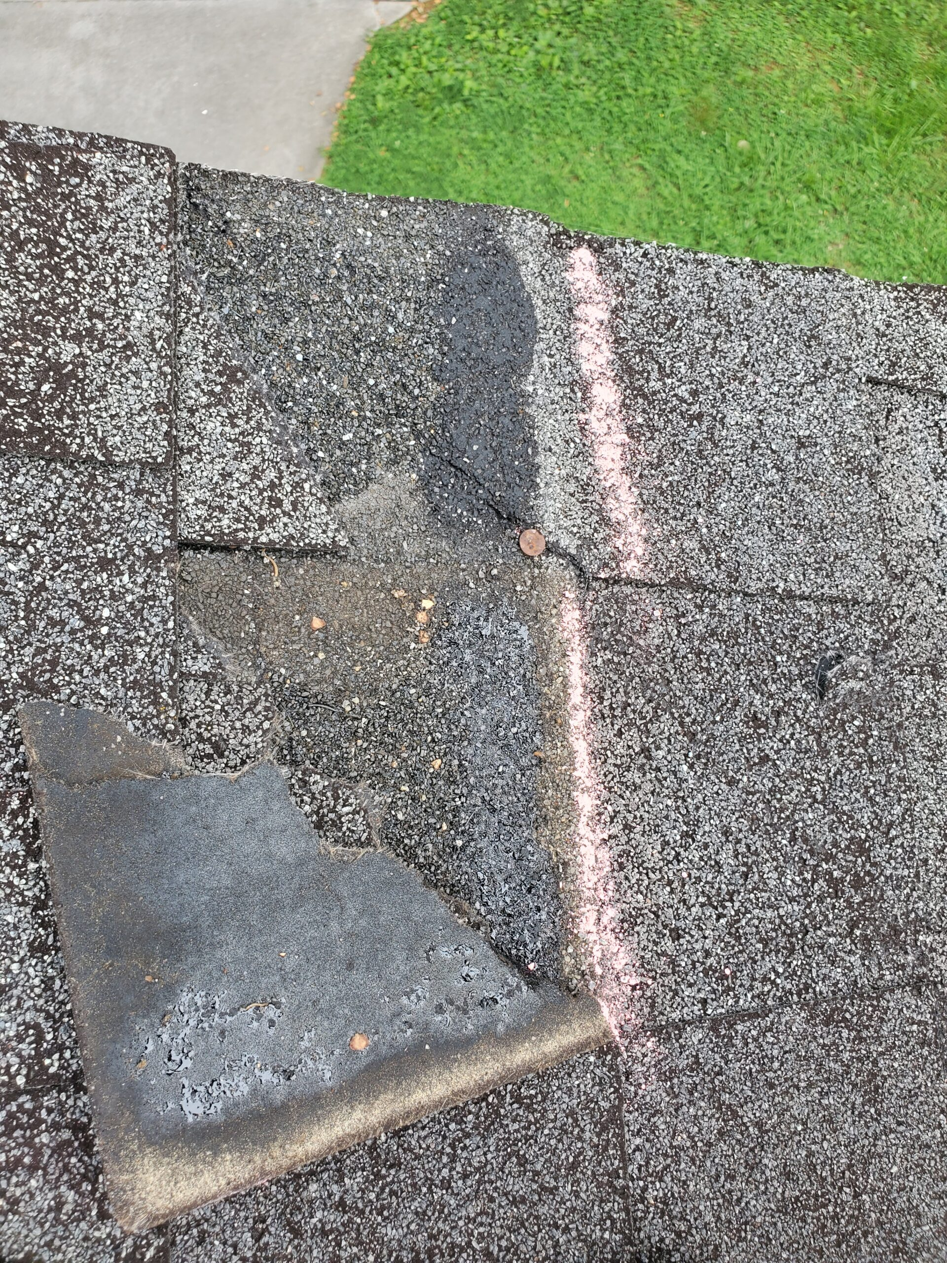 this is a picture of a shingle that has been blown off the roof