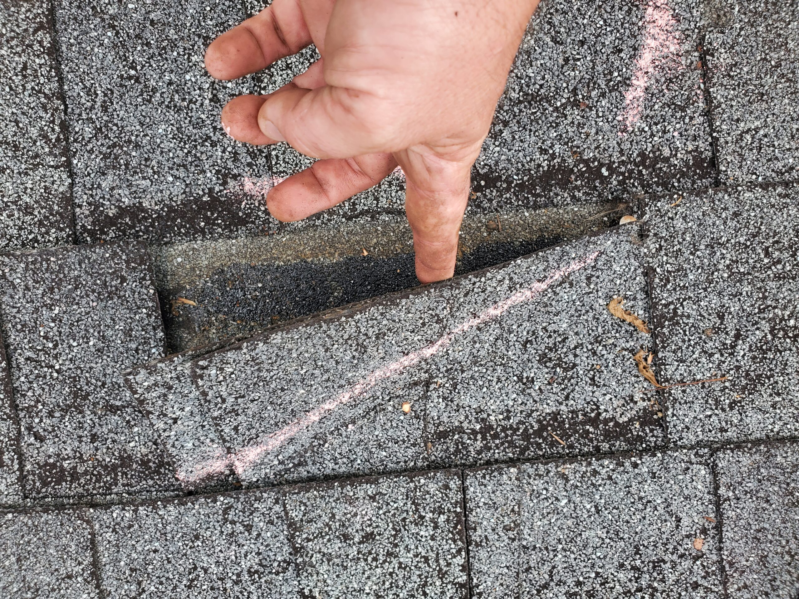 wind creased this shingle we used chalk to show the crease to the insurance aduster