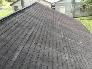 This is a picture of the ridge of a roof that will need to have structural work done at the peak